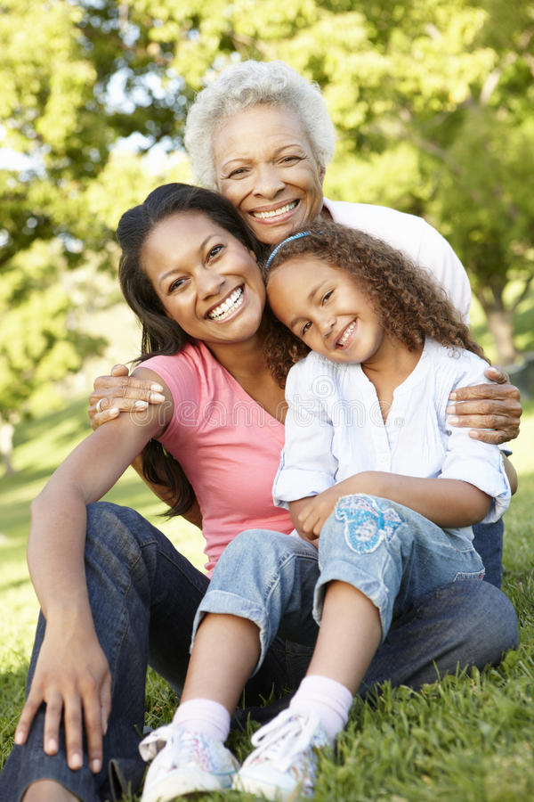 African American Grandmother, Mother And Daughter Relaxing In Pa. Rk royalty free stock photo