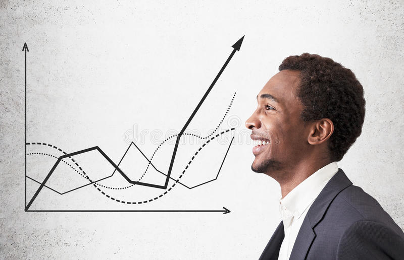 African American guy and graphs stock photo