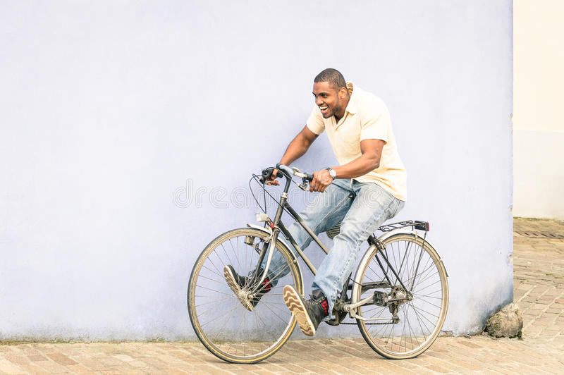 African american guy having fun with vintage bicycle - Free time stock photos
