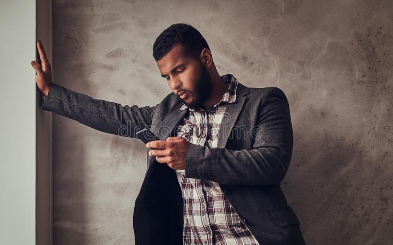 African-American guy using a phone in a studio. royalty free stock photo