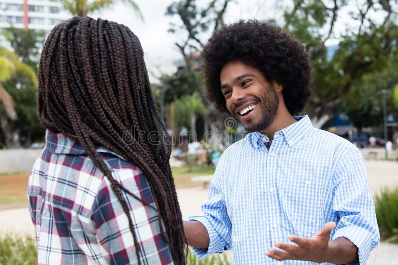 African american hipster man flirting with woman stock images
