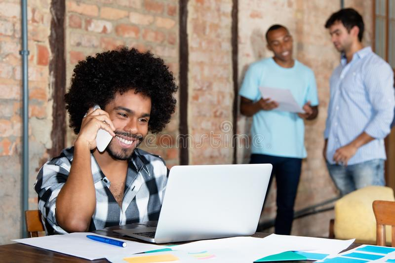 African american hipster software developer at startup company stock photos