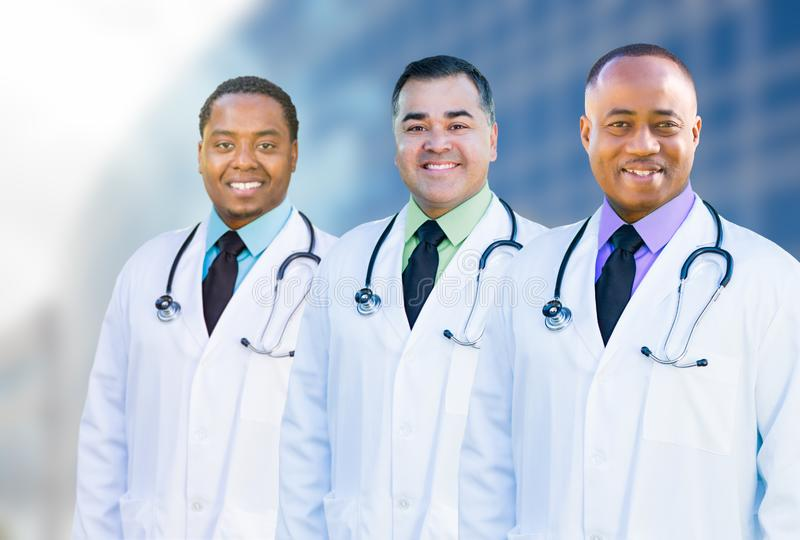African American and Hispanic Male Doctors Outside of Hospital B. Handsome African American and Hispanic Male Doctors Outside of Hospital Building royalty free stock photo