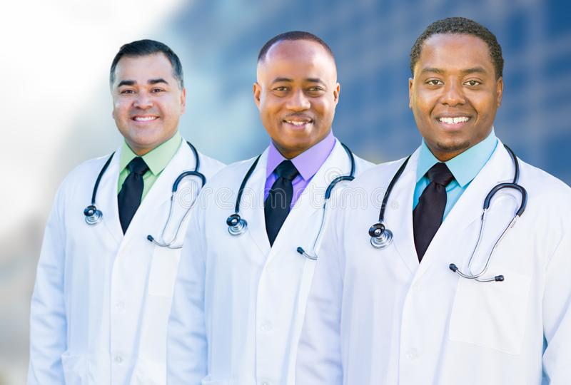 African American and Hispanic Male Doctors Outside of Hospital B. Handsome African American and Hispanic Male Doctors Outside of Hospital Building royalty free stock photography