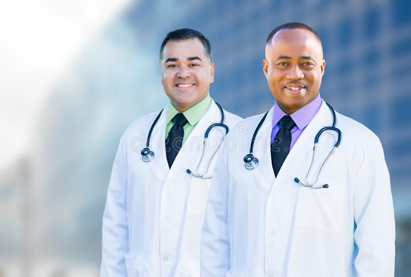African American and Hispanic Male Doctors Outside of Hospital B. Handsome African American and Hispanic Male Doctors Outside of Hospital Building royalty free stock images