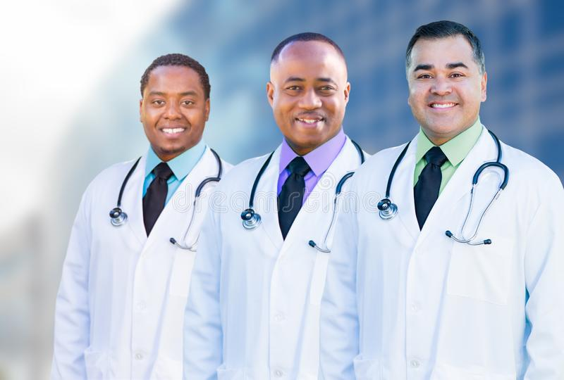 African American and Hispanic Male Doctors Outside of Hospital B. Handsome African American and Hispanic Male Doctors Outside of Hospital Building royalty free stock image