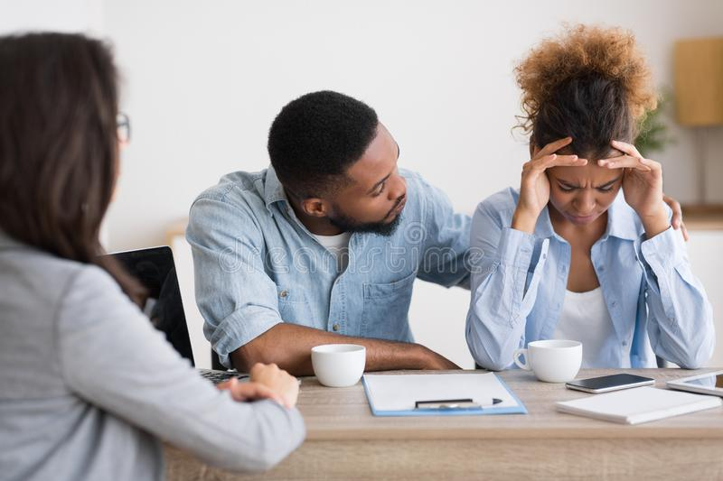 African American Husband Comforting Desperate Wife Crying On Family Counseling stock image