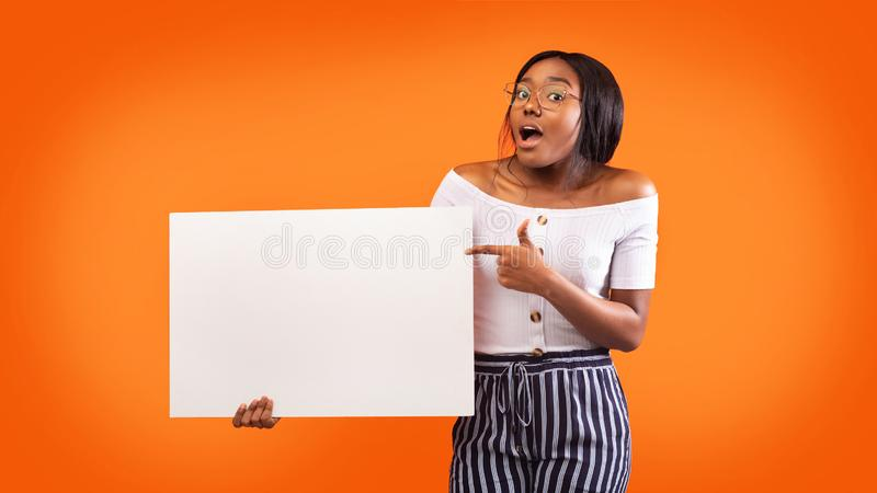 African American Lady Pointing Finger Holding White Board, Studio, Mockup stock image