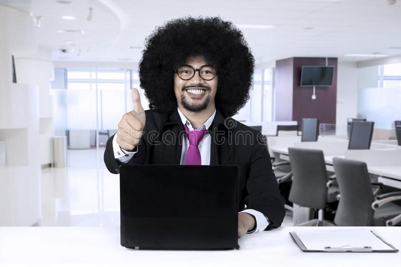 African american with laptop relaxing at office royalty free stock images