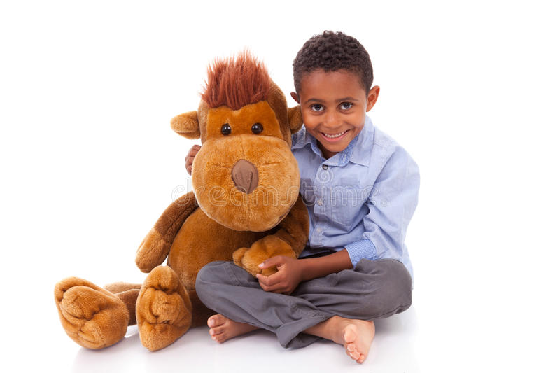 African American little boy holding a plush - Black people stock photography