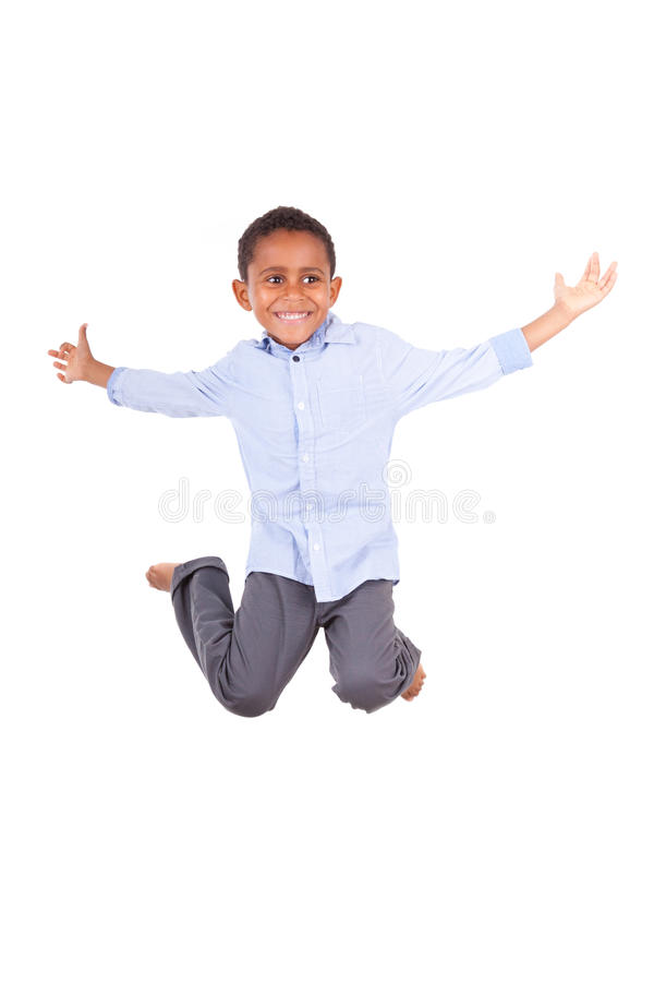 African American little boy jumping - Black people stock image