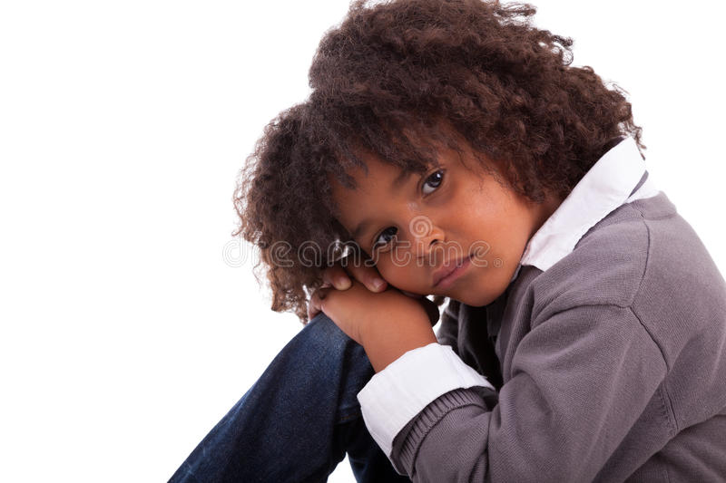 Download African American Little Boy Sitting On The Floor Stock Photo - Image: 25499300