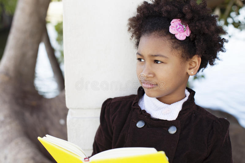 African american little girl with book royalty free stock photography