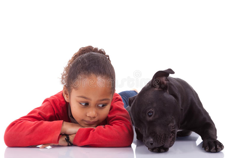 African American little girl with her pet stock photography