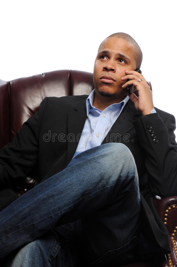 African American Male. Funny looking African American male holding antique phone stock photography