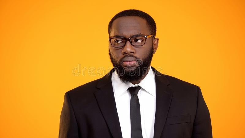 African-american male in business suit looking aside, eyesight and ophthalmology stock photo