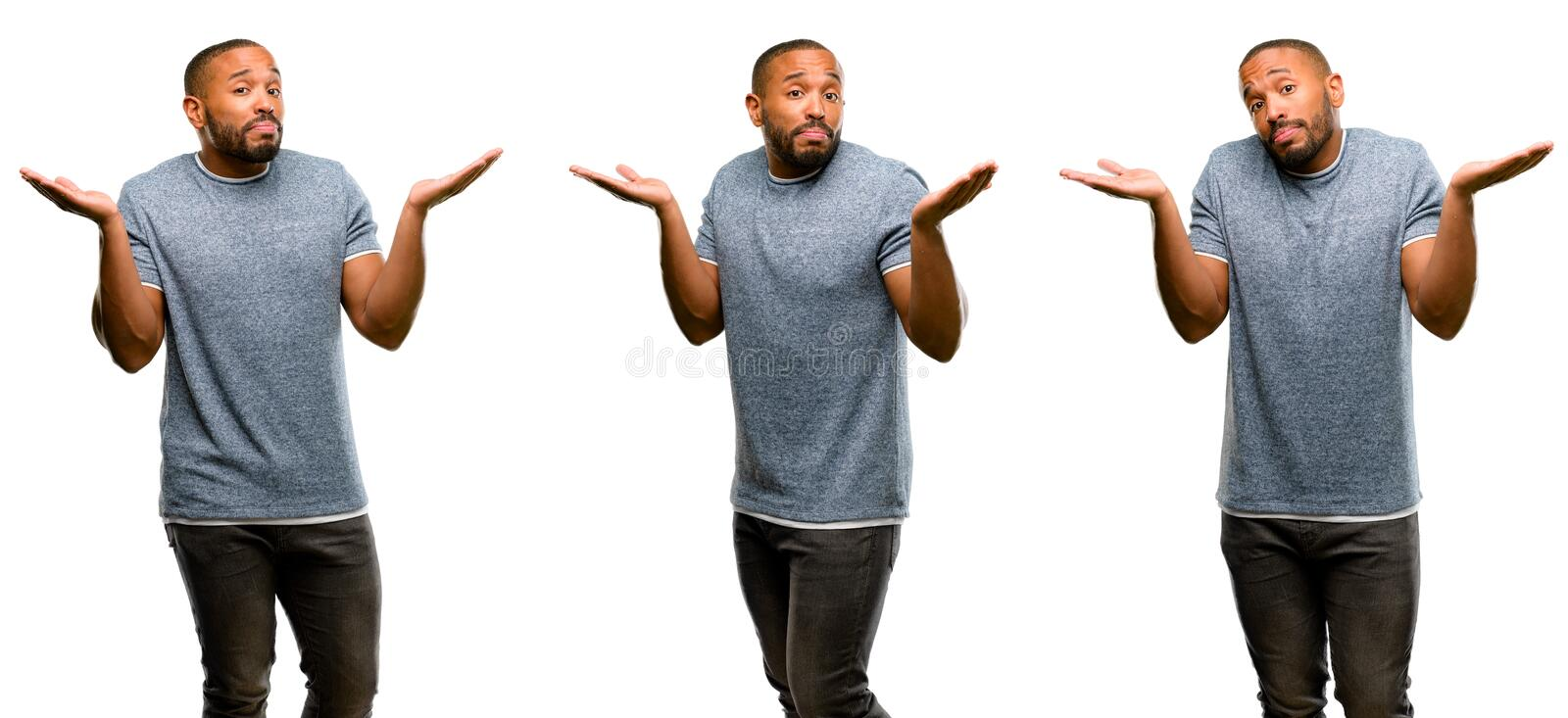 African young man isolated over white background. African american man with beard doubt expression, confuse and wonder concept, uncertain future shrugging royalty free stock photo