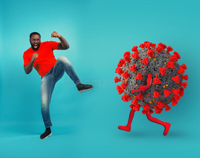 African-American man fighting with bare hands against a big virus on cyan background stock photos