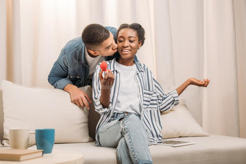 man gifting ring to woman stock photo