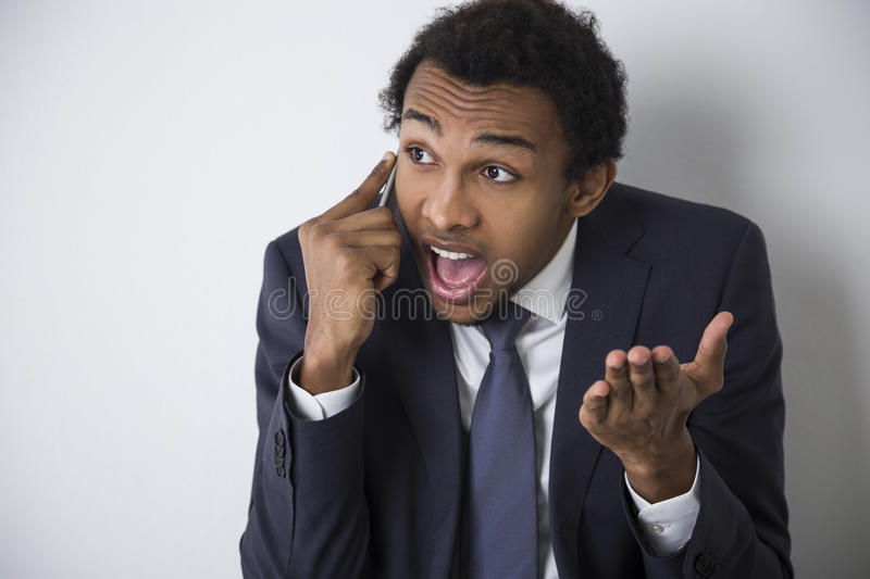 Download African American Man On The Phone Explaining Stock Image - Image: 83722119