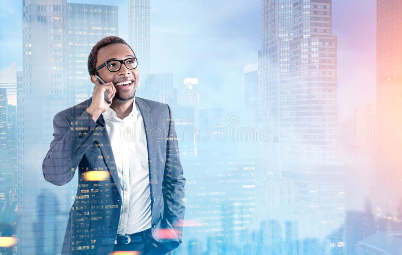 African American man on phone, morning city stock photos