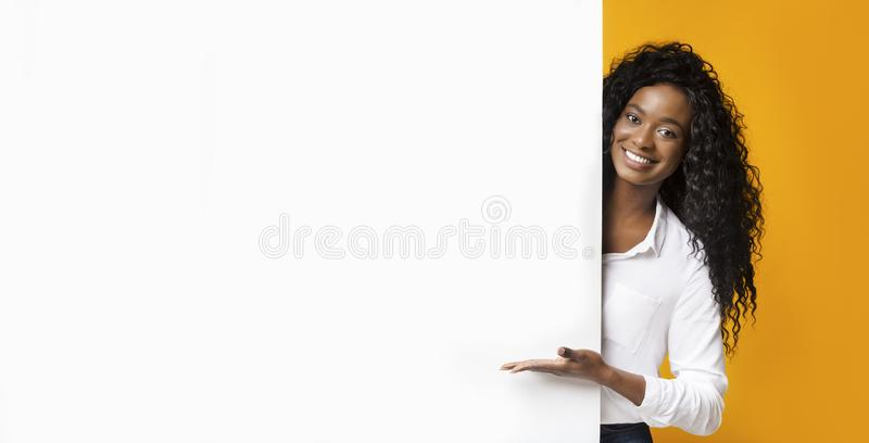 African-american man pointing at white blank board stock photo