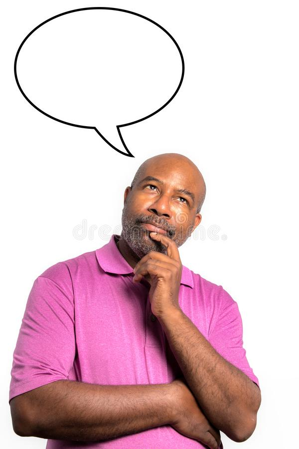 African American man in purple shirt thinking with a speech bubble above his head against a white background royalty free stock image