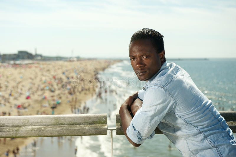 Download African American Man Relaxing At The Beach On A Summer Day Stock Photo - Image: 32885360