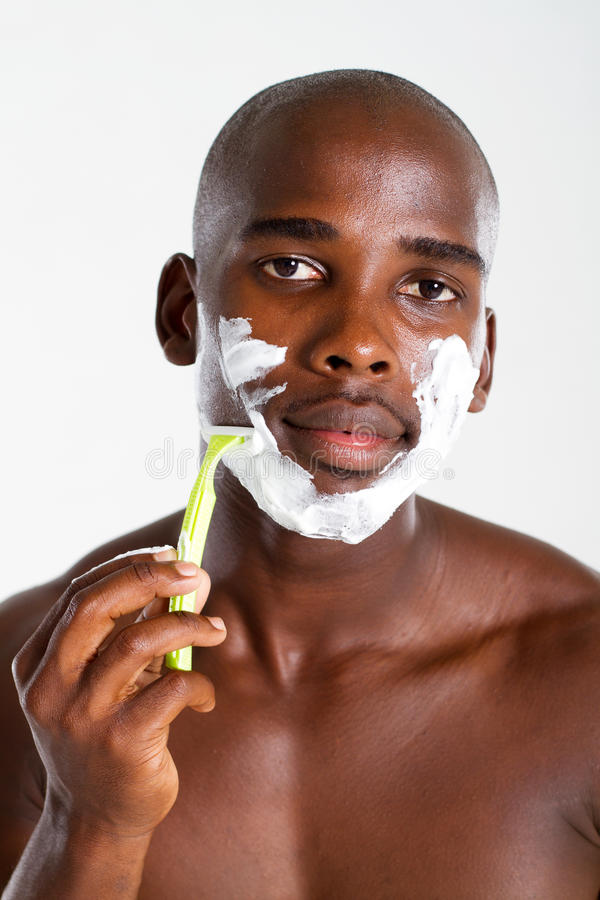 African american man shaving royalty free stock images