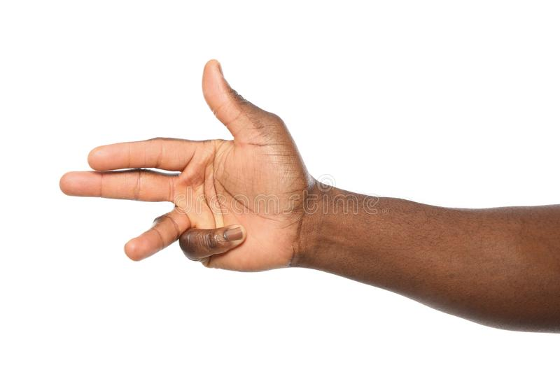 African-American man showing number THREE on white background stock photos