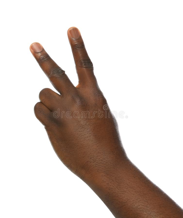 African-American man showing number TWO on white background stock photos