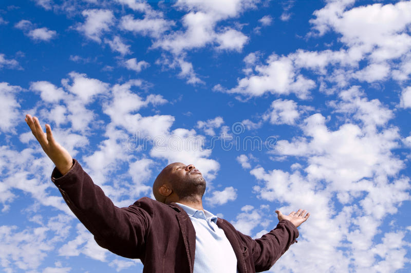 African American man stading outside with open arms. royalty free stock images