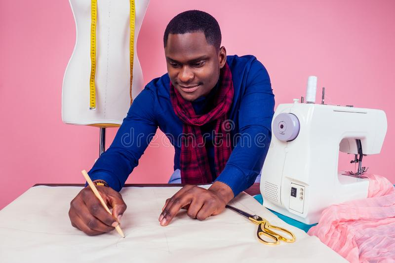 African American man tailor seamstress workshop stylish male model clothes designer the process of creating a new. African American man tailor seamstress stock image