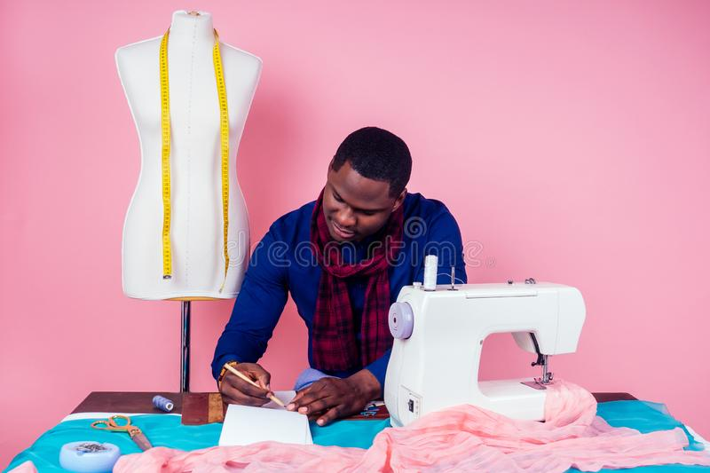 African American man tailor seamstress workshop stylish male model clothes designer the process of creating a new. African American man tailor seamstress stock photos