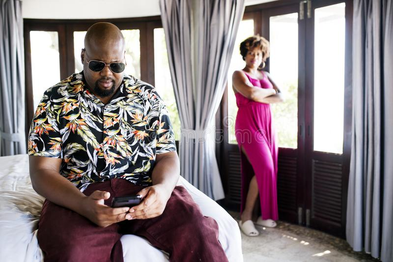 African American man using phone on vacation. African American men using phone on vacation stock photo