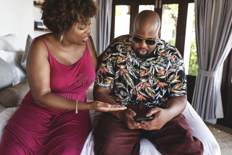 African American man using phone on vacation. African American men using phone on vacation royalty free stock photo