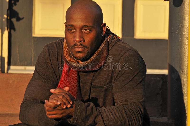 African American Man Warming Up on Cold Evening stock image