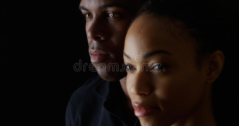 African American man and woman on black background stock photos