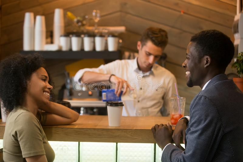 African-american man and woman flirting talking at coffeeshop ba stock photo