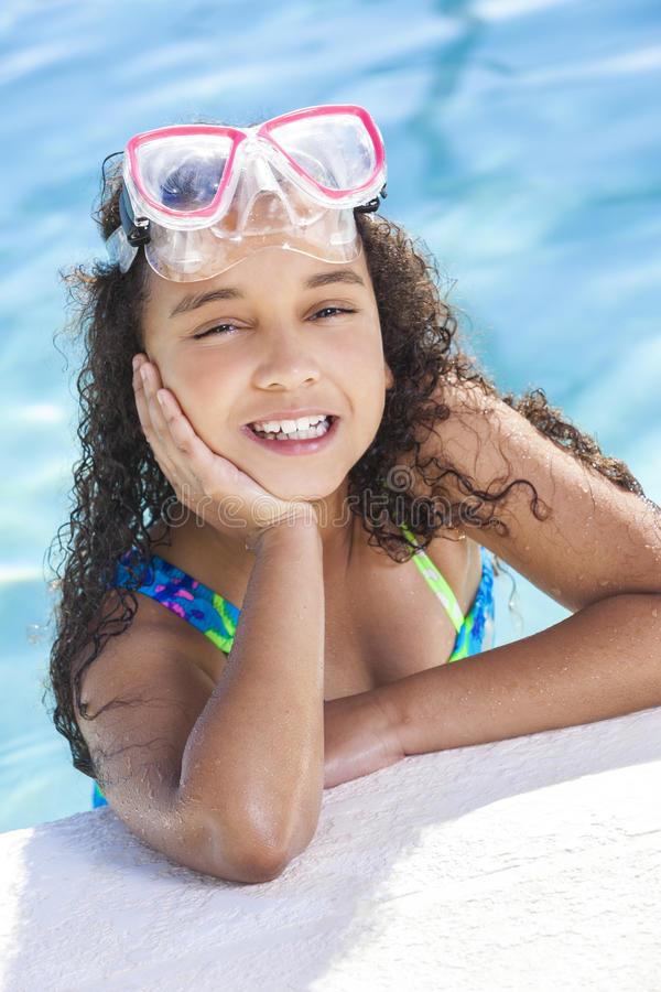 African American Mixed Race Girl Child In Swimming Pool royalty free stock photography