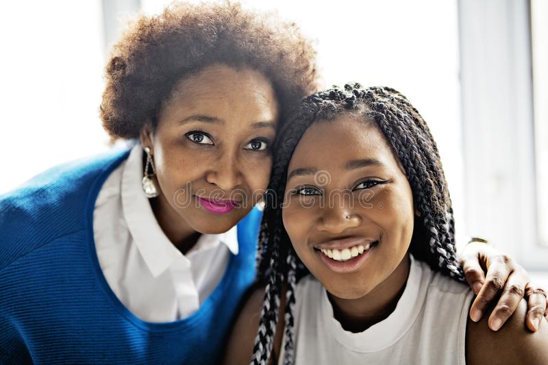 African American mother and daughter close portrait royalty free stock images