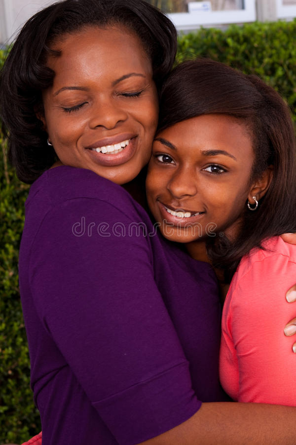 African American mother and daughter hugging. royalty free stock photography