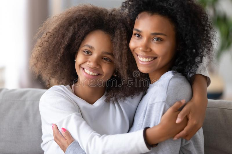 African American mother and daughter hugging, posing for family photo royalty free stock photography