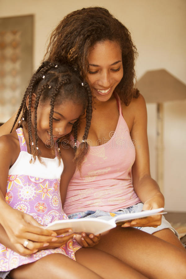 African american mother and daughter studying royalty free stock images
