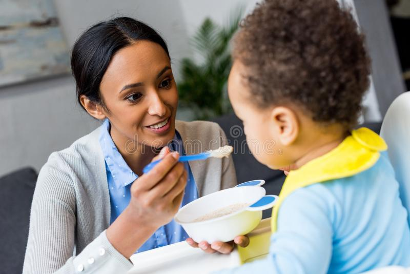 African american mother feeding baby royalty free stock photos