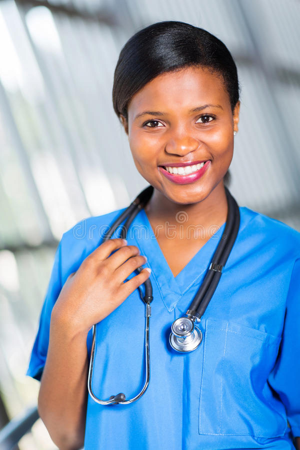 African american nurse. Happy african american nurse in hospital stock photo