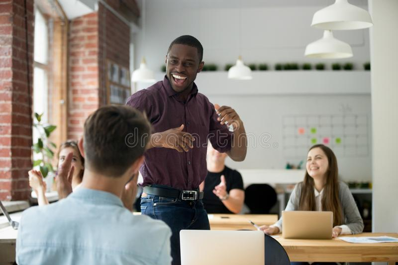 African american office worker dancing surrounded by colleagues stock photography