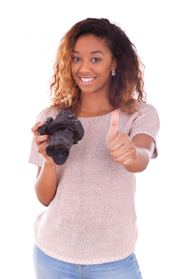 African American photographer holding a dslr camera making thumb. S up gesture stock photo