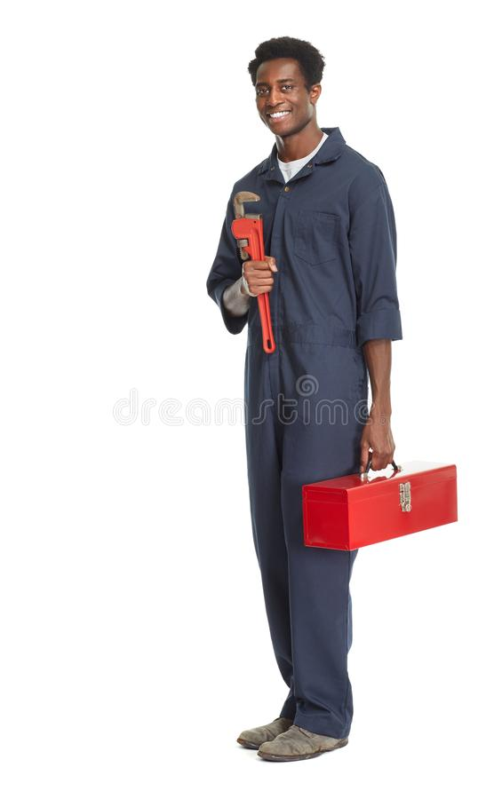 African American Plumber. African American plumber with wrench isolated white background royalty free stock photography