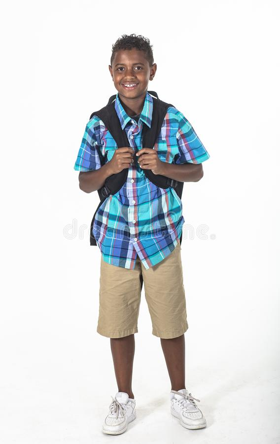 African American school boy with backpack isolated on white stock photo